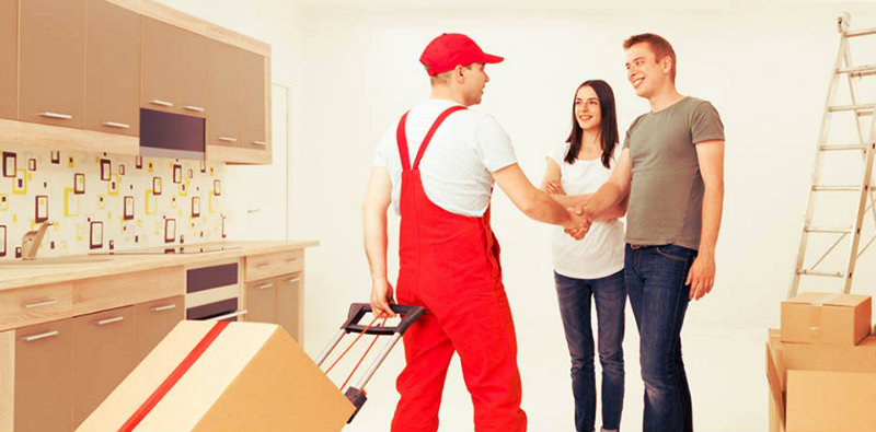 happy couple shaking hands with their removalist