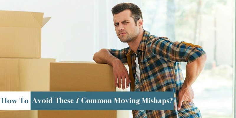man with hand on back is leaning on moving boxes